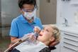 canvas print picture - Patientin bekommt eine professionelle Zahnreinigung