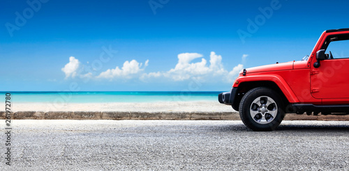 Red summer car and beach landscape. Free space for your decoration.