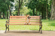 canvas print picture - Cute Pembroke Welsh Corgi dog on a bench in the park