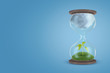 3d rendering of an hourglass with thick clouds in its upper half and a green sprout in the lower half on a light-blue background.