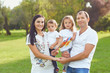 canvas print picture - Happy family with children smiling in the park.