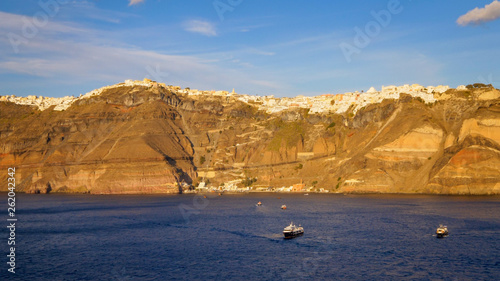 Picturesque cliffside town of Fira on the mediterranean island of  Santorini, Greece,
