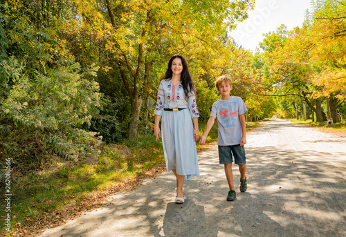 happy mother and son on the background of autumn trees