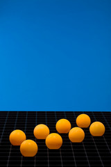 Abstract still life with orange balls on a blue background