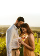 Romantic couple standing together in a vineyard