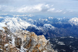rugged cliffs and snow-capped mountains in the bavarian alps in germany, view from the zugspitze towards austria
