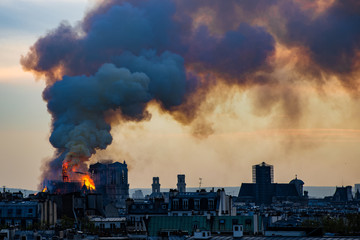 Notre Dame fire on Paris during sunset