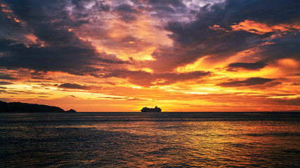dramatic sunset skyline with seascape and travel cruise ship © bank215