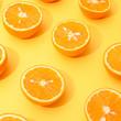 canvas print picture - Orange juicy oranges split in half on yellow