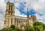 The Notre Dame De Paris- Our Lady of Paris  cathedral,  against cloudy sky.
