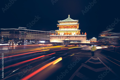 Xian bell tower at night, long exposure with car light tracks, color toning applied, China.