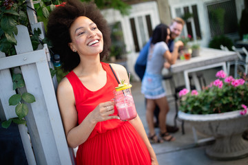 Healthy drinks, diet and people concept. Close up of beautiful afro woman