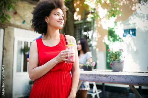 canvas print picture Summer lifestyle fashion portrait of stylish black woman with drink