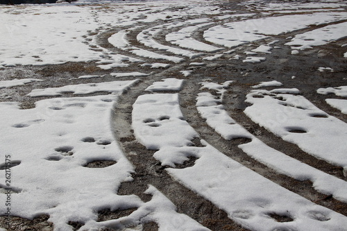canvas print picture Car tyres tracks in the snow
