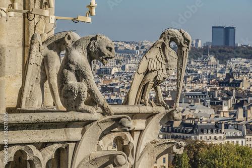 fototapeta na ścianę Famous Stone demons gargoyle and chimera on Notre Dame de Paris. View from top of Notre Dame de Paris. France.
