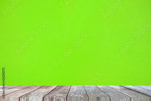 Leinwandbild Motiv Empty Wooden Table with Green Painted Concrete Background, Suitable for Presentation, Web Temple, Backdrop, and Product Display.