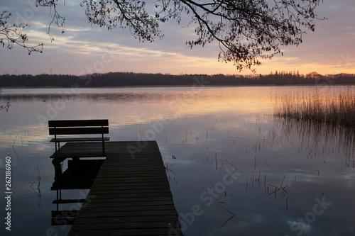 Acrylglas Pier sunrise at the lake