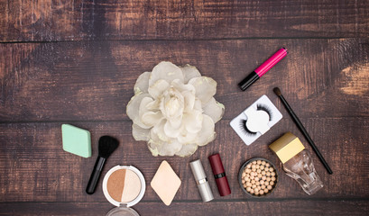 Make up beauty and cosmetics products for woman on wooden background