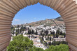 View of Granada through the arched window from the Generalife gardens in Granada, Spain - 262188363