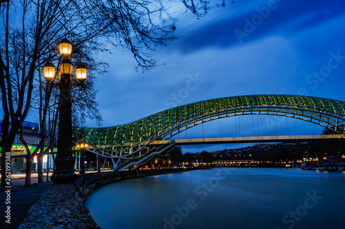 fototapeta na ścianę The bridge of peace in Tbilisi, Georgia. Beautiful lighting of the friendship bridge by night. The main attraction of the town.