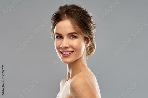 canvas print picture beauty and people concept - smiling young woman with bare shoulders over grey background