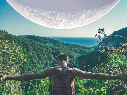 traveling young man and huge planet in the sky b
