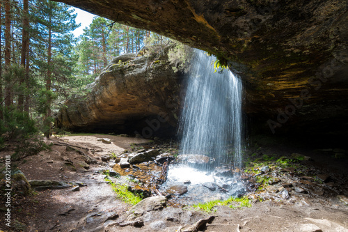 beautiful waterfall view from inside a cave - 262219108