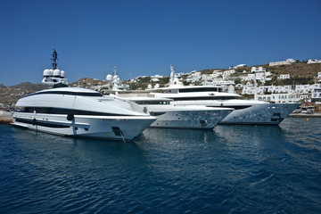 beautiful white yachts moored in the port of Mykonos