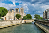 PARIS, FRANCE - JULY 2014: Exterior view of Notre Dame with tourists. This is the most visited landmark in France - 262228731