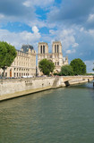 PARIS, FRANCE - JULY 2014: Exterior view of Notre Dame with tourists. This is the most visited landmark in France - 262228739