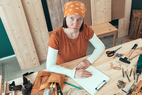 canvas print picture Portrait of self employed female carpenter in her woodwork workshop