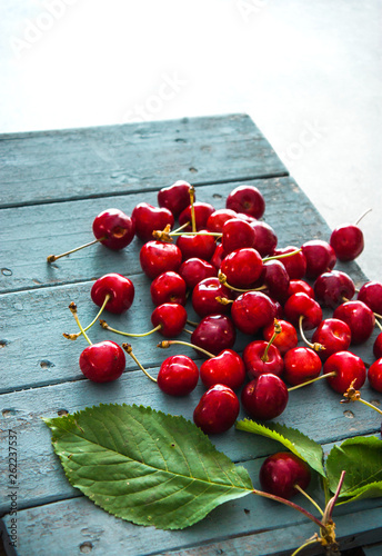 Fresh cherries on wood © mythja
