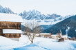 Quadro Dolomites mountain peaks with Val di Funes village in winter, South Tyrol, Italy