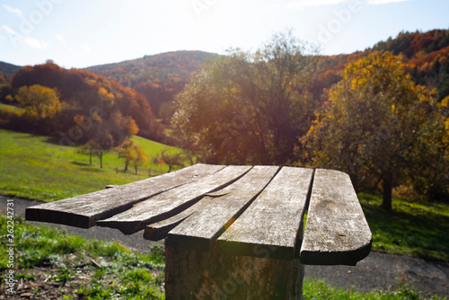 Wooden table in an autumn landscape