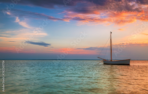 Lonely boat on the Baltic Sea at sunset
