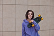 Portrait of a happy young girl with skateboard. Woman with skateboard