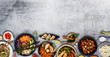 Top view composition of various Asian food in bowls