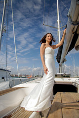 Bride poses on a sailboat