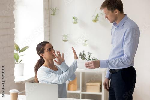 Leinwandbild Motiv Woman refuse to accept envelope with money from boss