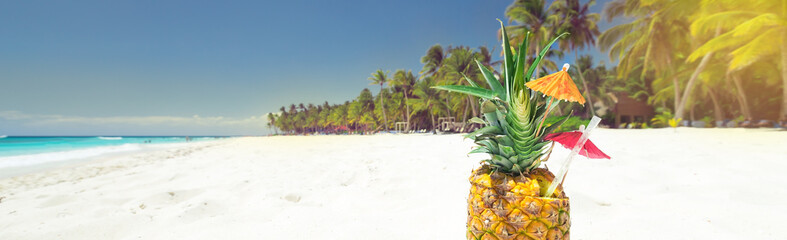 Pineapple cocktail on sand with copy space © photopixel