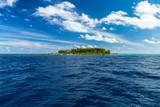 view from boat on sea ocean of tropical paradise maldives island resort with coral reef and turquoise blue ocean tourism blue sky background - 262330348
