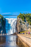 QUEBEC, CANADA - September 16, 2018: The Montmorency Falls is a waterfall on the Montmorency River in Quebec, Canada. The many tourists that visit there are treated to many ways to see the falls