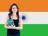 Hindi language school concept. Perfect brunette woman student with book on the India flag background