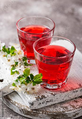 Leinwanddruck Bild Glasses of healthy cherry juice