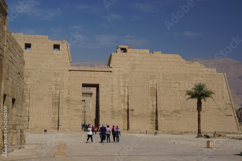Luxor, Egypt: Tourists visit Medinet Habu, the mortuary temple of Ramesses III, an important New Kingdom structure on the West Bank of the Nile River.