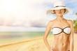 Leinwanddruck Bild - Beautiful woman in blue swimsuit on tropic sea background