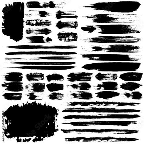 Set of vector strokes with a dry brush. Abstract black spots and strokes isolated on white background. Grunge style templates for text, icons © Alexandr