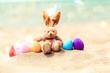 Quadro Easter bunny and color eggs on beach sand