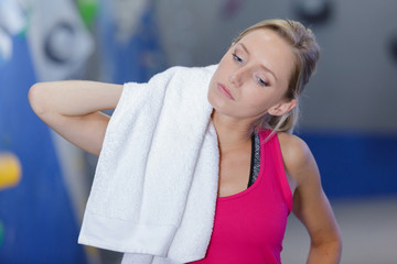 closeup of tired after sport young fitness girl with towel