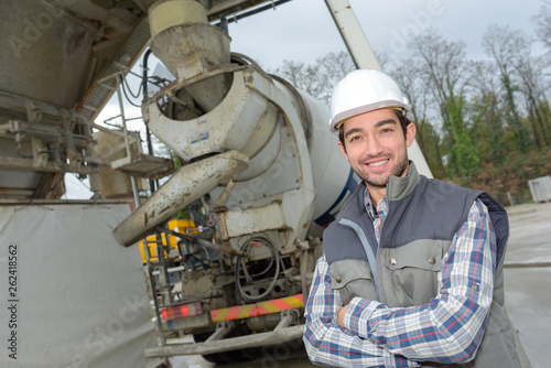 canvas print picture portrait of male worker stood by cement transporting lorry
